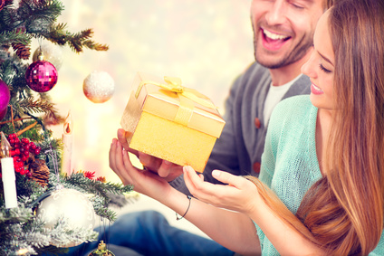 Happy Couple with Christmas Gift at Home